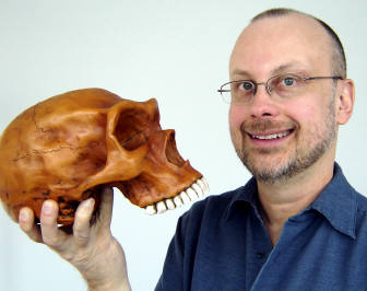 [Robert J. Sawyer with Neanderthal skull]